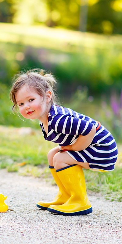 Little girl in wellies